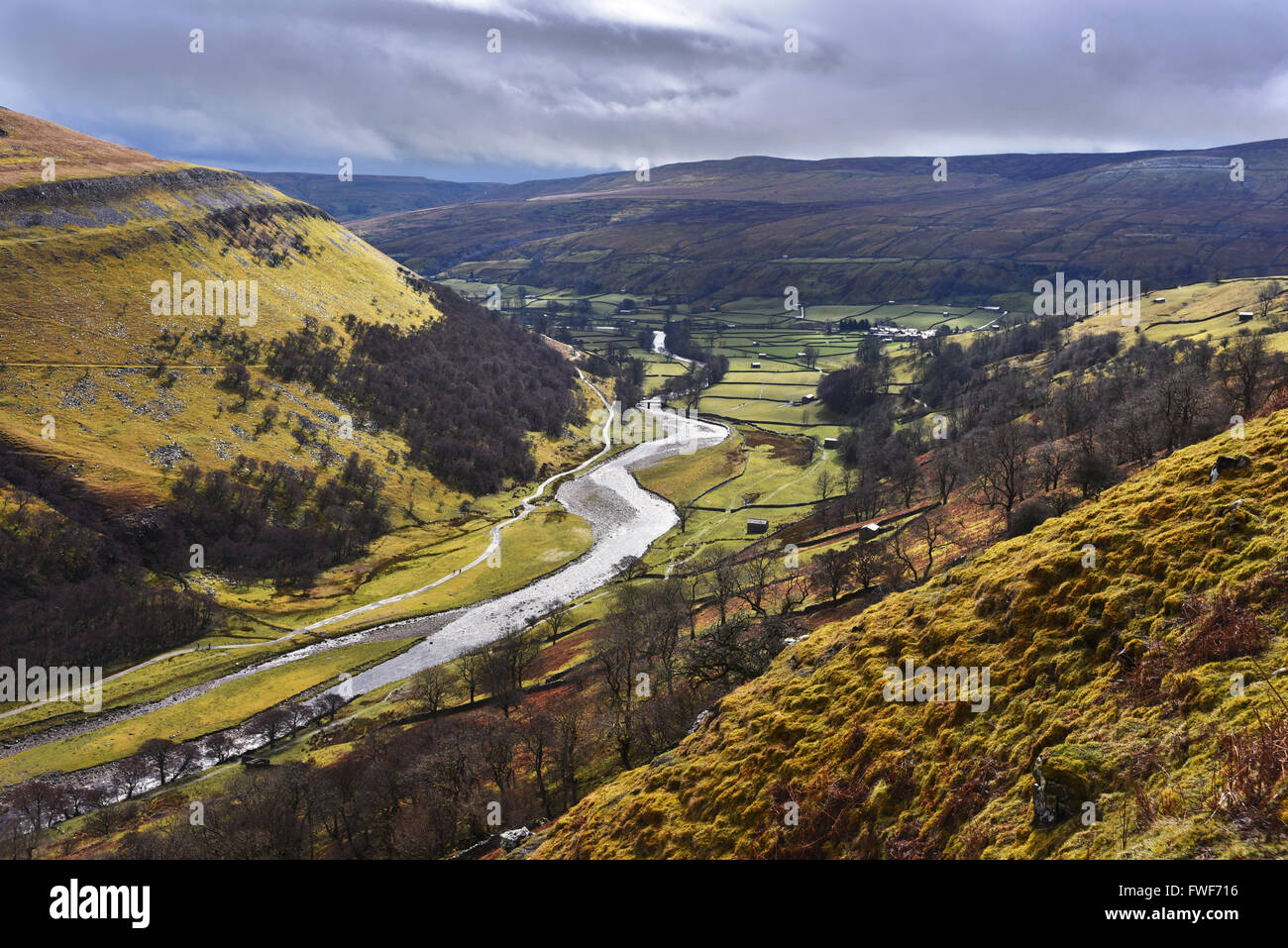 The River Swale and the village of Muker, Swaledale, North Yorkshire, Uk - Stock Image
