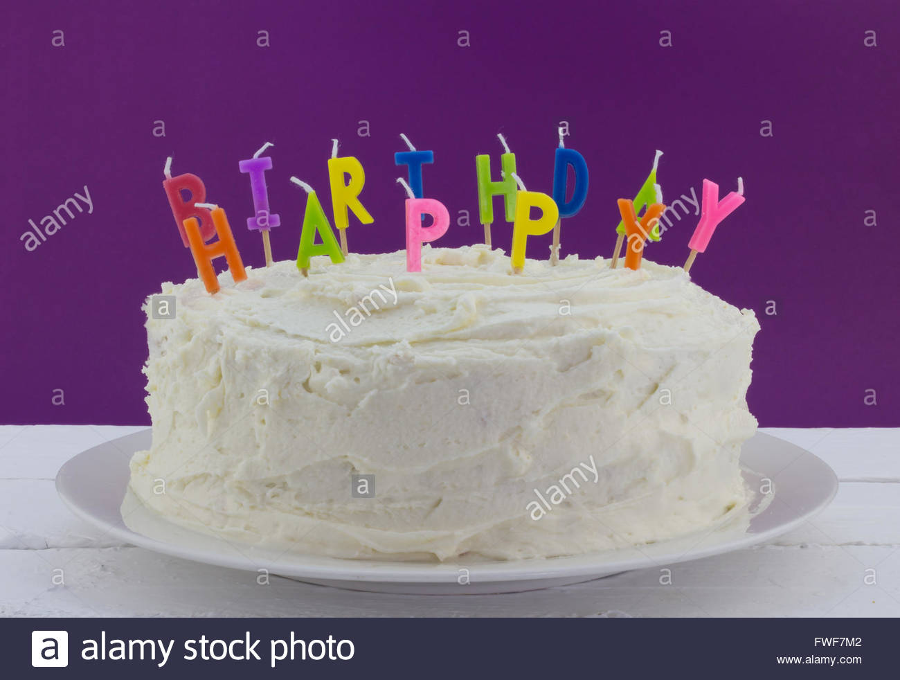 Birthday Cake On White Table With Unlit Candles