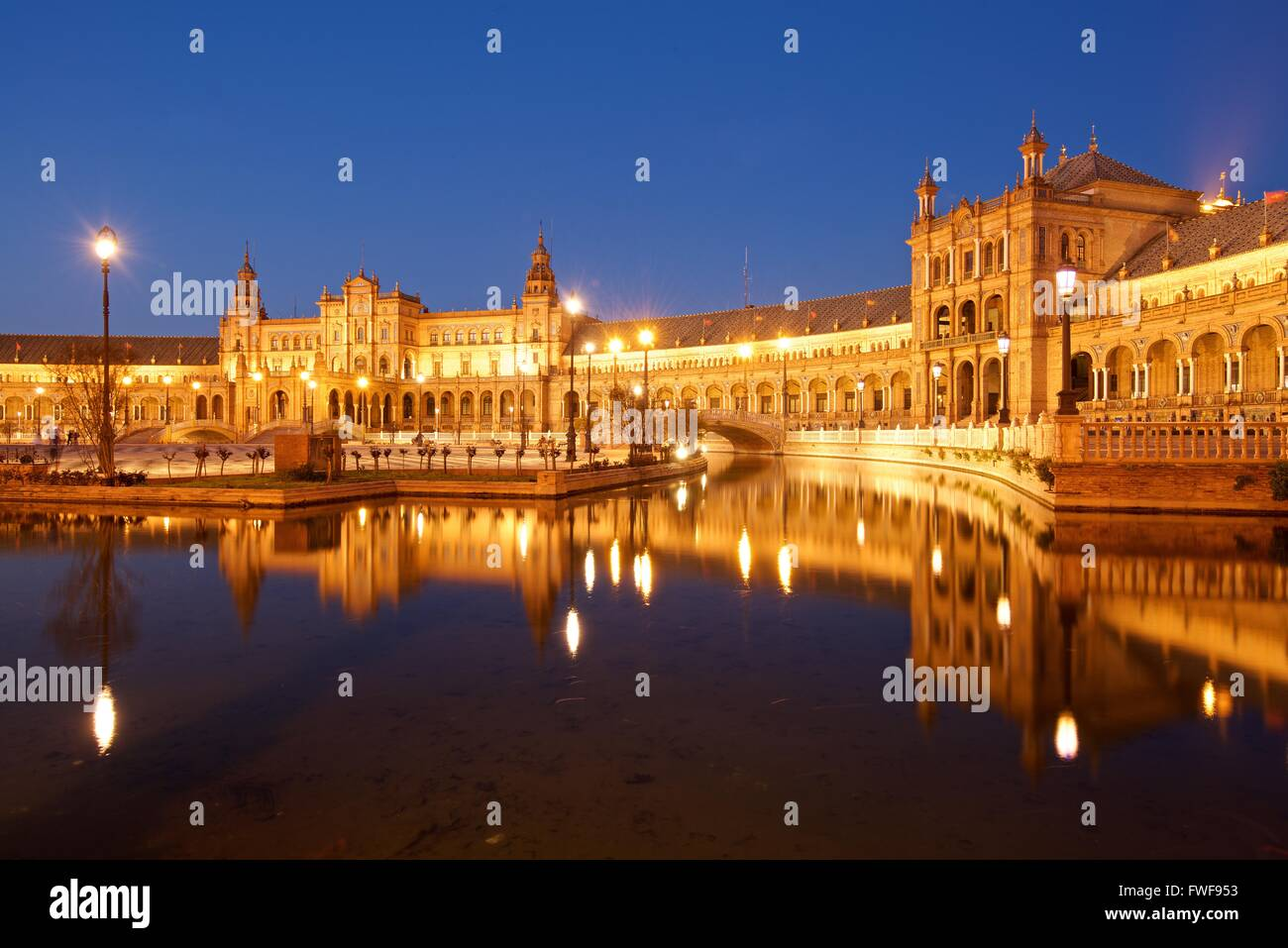 A colour image of the flood lit Plaza De espanga in Seville at night - Stock Image