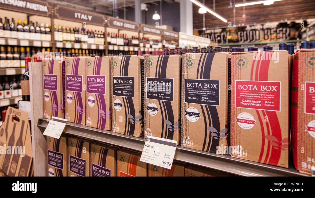 a display of Bota Box wine in a grocery store in the liquor department - Stock Image