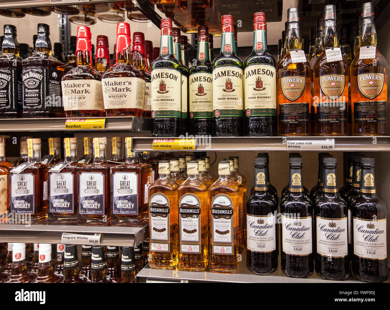bottles of alcohol on the shelves of a liquor store Stock Photo