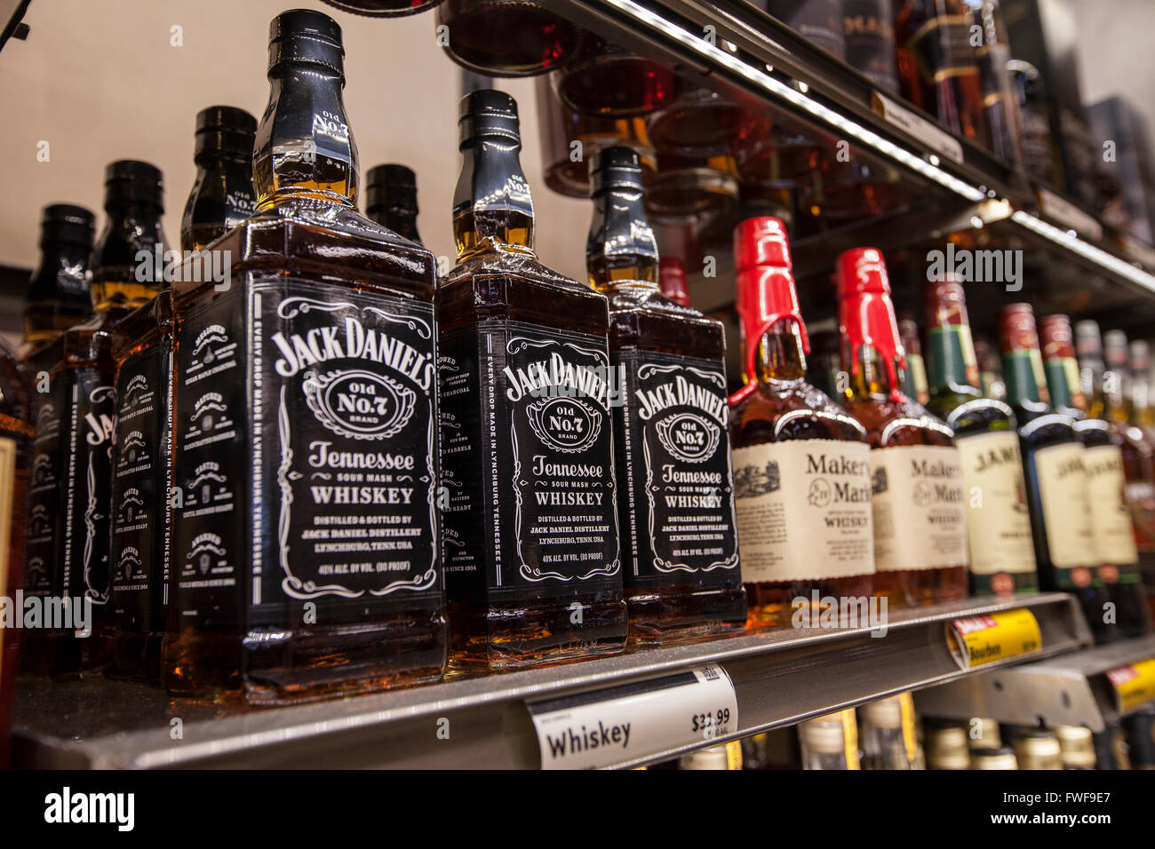 bottles of Jack Daniel's whiskey on a shelf at a store Stock Photo