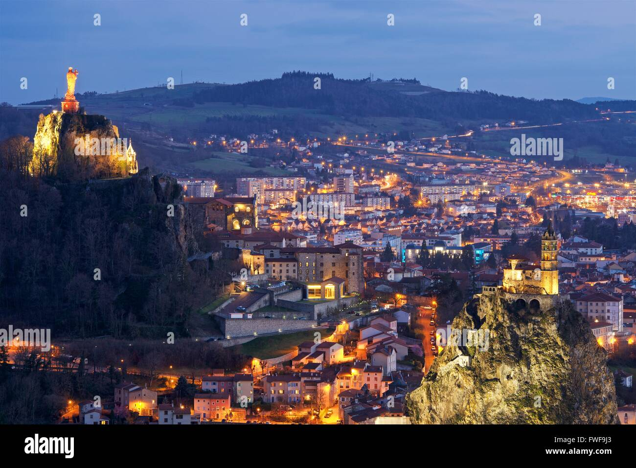 A colour image taken at dusk of the town of le puy-en-velay in france - Stock Image