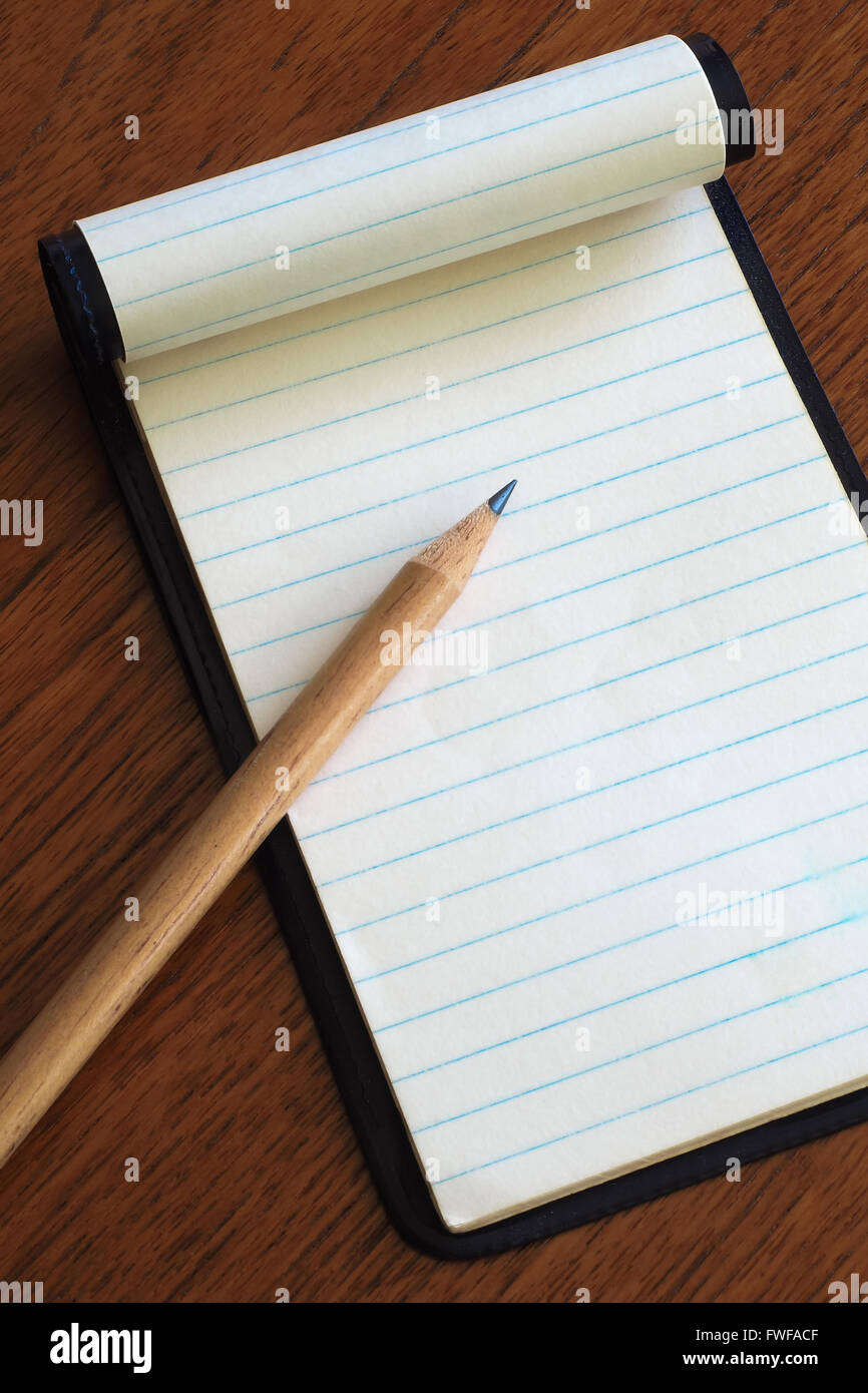 Note Pad with Pencil - Stock Image