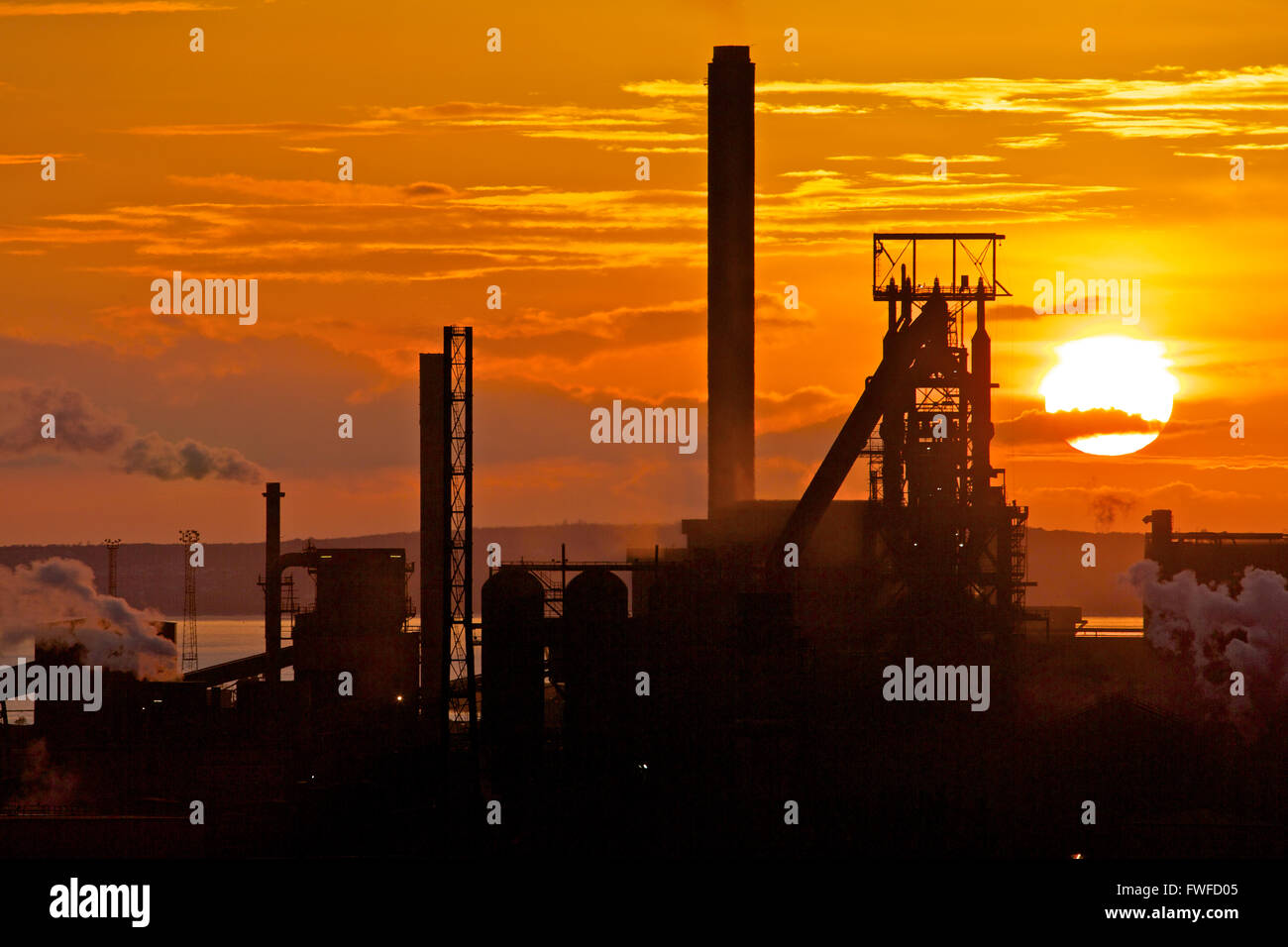 Tata Steel works, Port Talbot, South Wales, UK. 4th April 2016. Sun setts over Tata Steel works, Port Talbot, South Wales, on a day that the Welsh Government was reconvened to discuss the crisis. Over 4000 jobs are under risk after Tata steel announced it's intention last week to sell it's steel working sites across the UK. Credit:  Haydn Denman/Alamy Live News Stock Photo