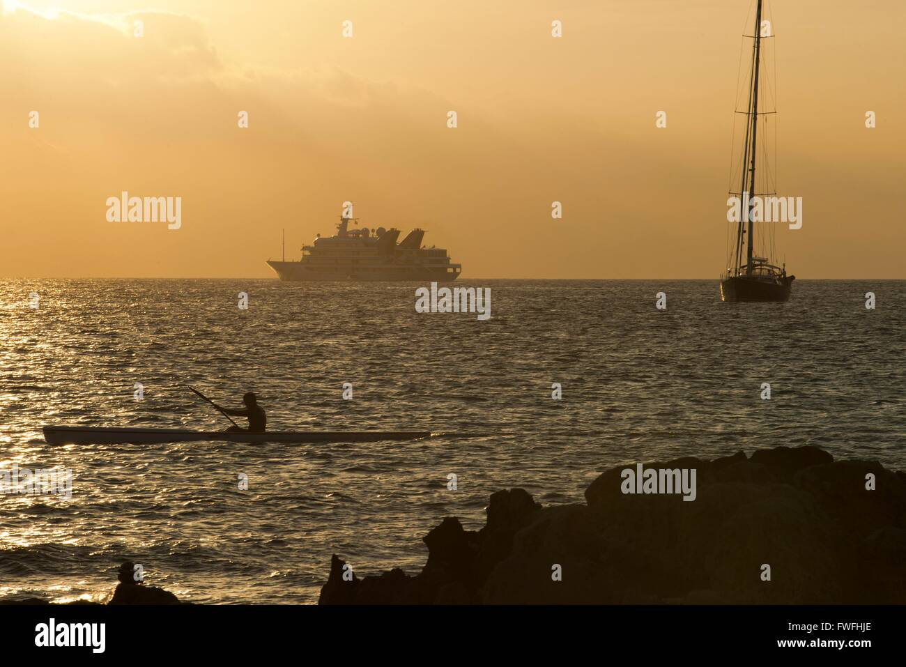 Ses Illetes Beach, Balearic Islands, Formentera, Spain. Boats, raw and backlights in the sunset. - Stock Image