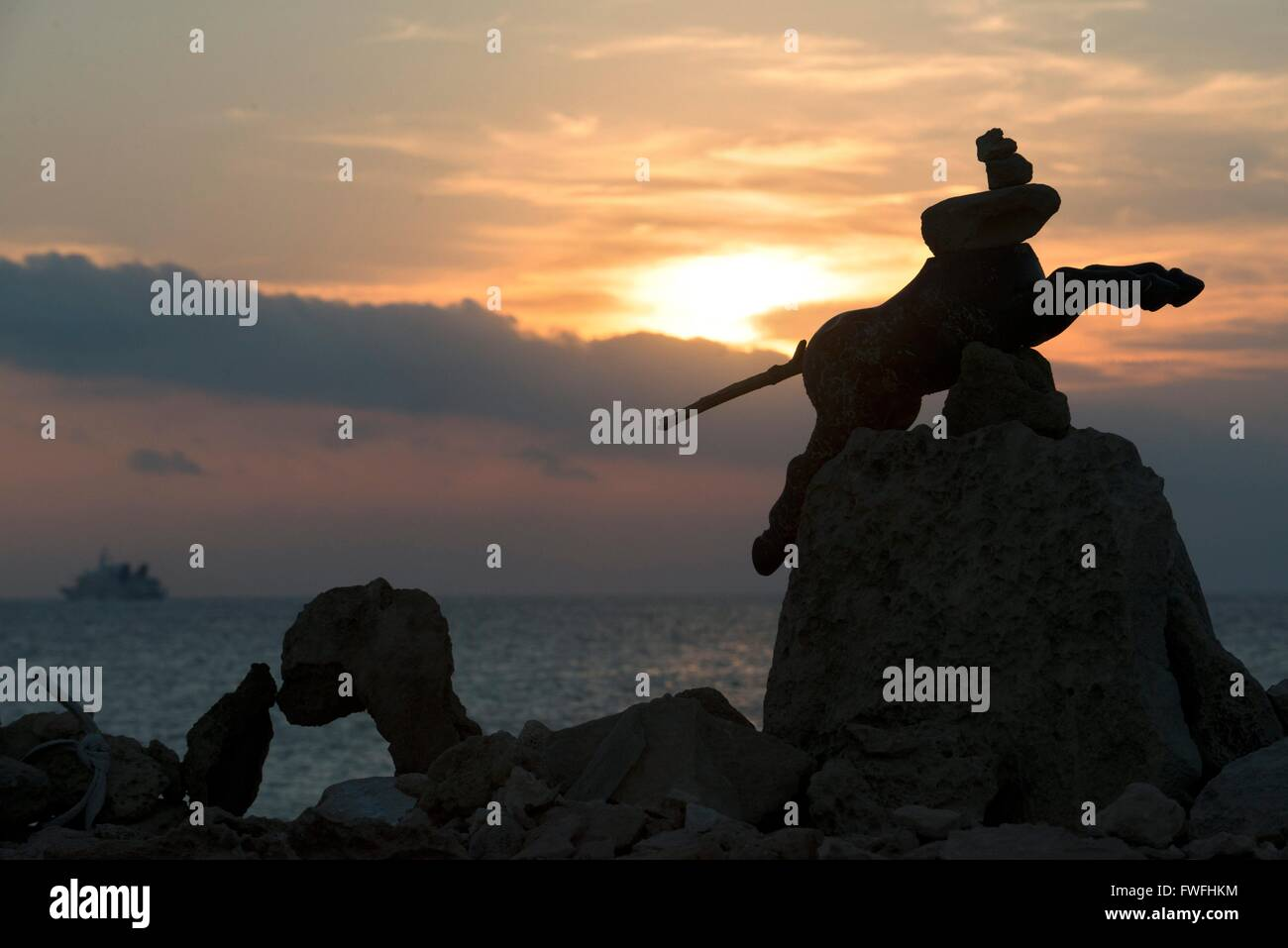 Ses Illetes Beach, Balearic Islands, Formentera, Spain. Backlights in the sunset with stones with different shapes. - Stock Image