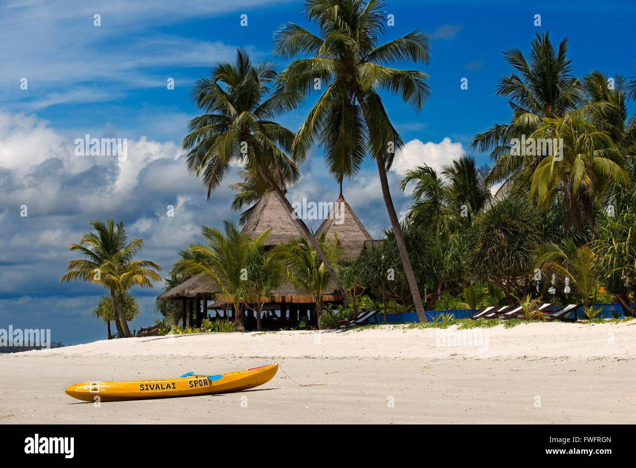 Kayak on a Hotel on a palm-lined beach, Koh Mook Sivalai Beach Resort Hotel, island of Ko Muk or , Thailand, Southeast - Stock Image