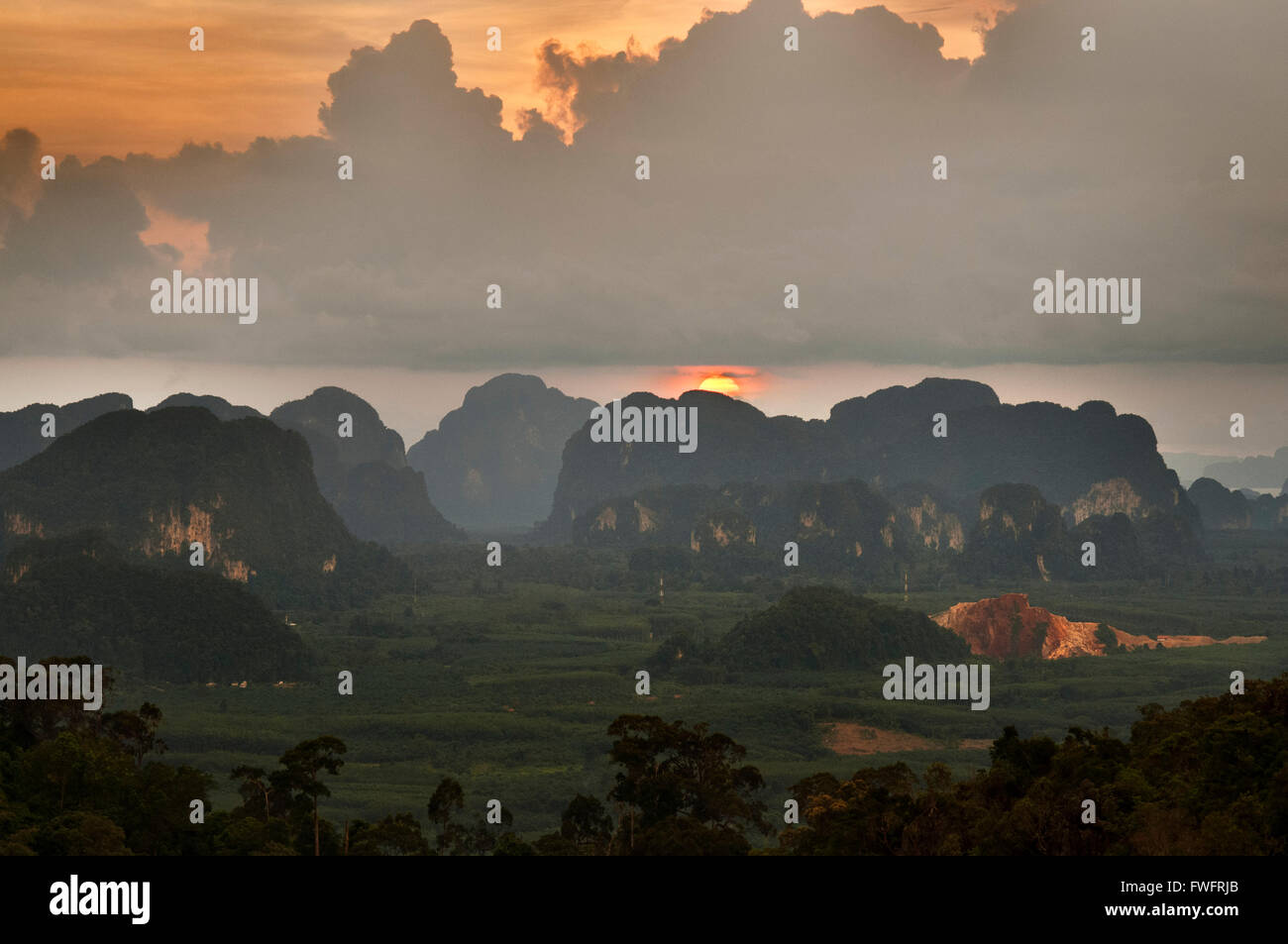 Sunset view of the beauty mountains from Buddhist shrine and statue on top of the mountain towards Tiger Cave Temple - Stock Image