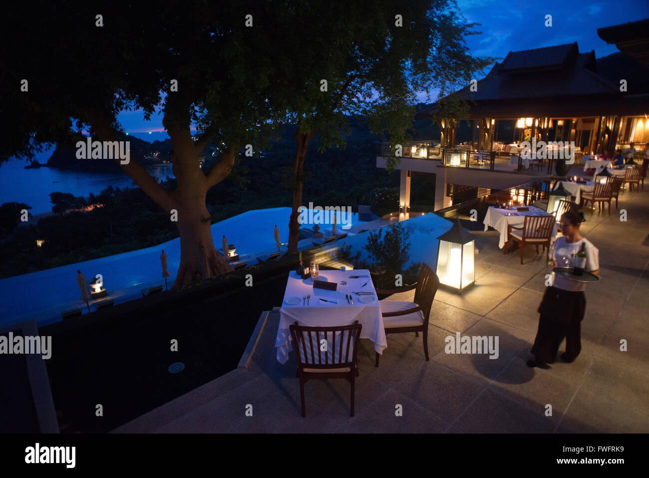 Sunset. Restaurant in fornt of the pool at the luxury hotel Pimalai Resort, Kantiang Beach, Ko Lanta or Koh Lanta island, Krabi, Stock Photo