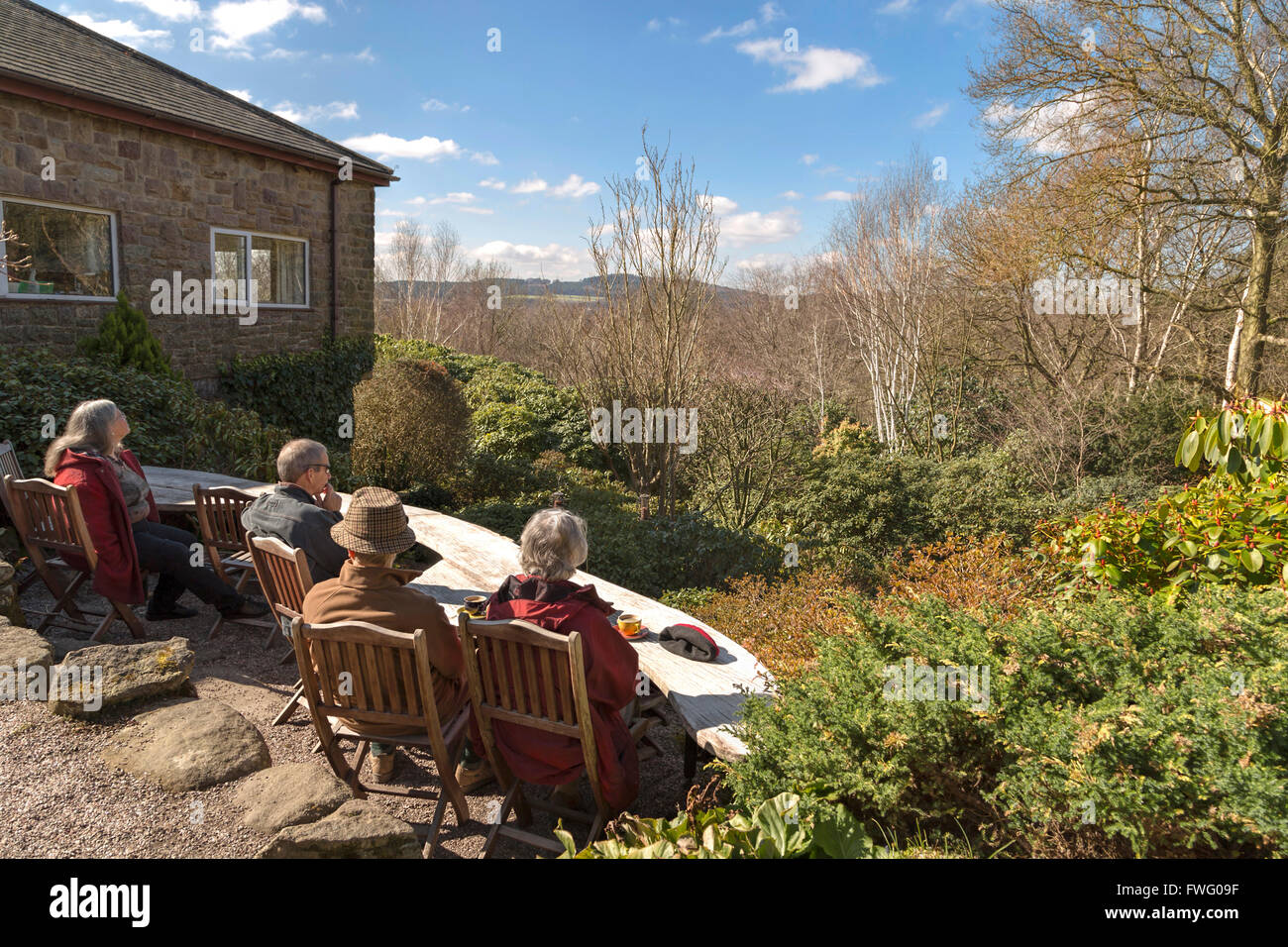 Visitors enjoying the view on the woodland garden at Lea Gardens ...
