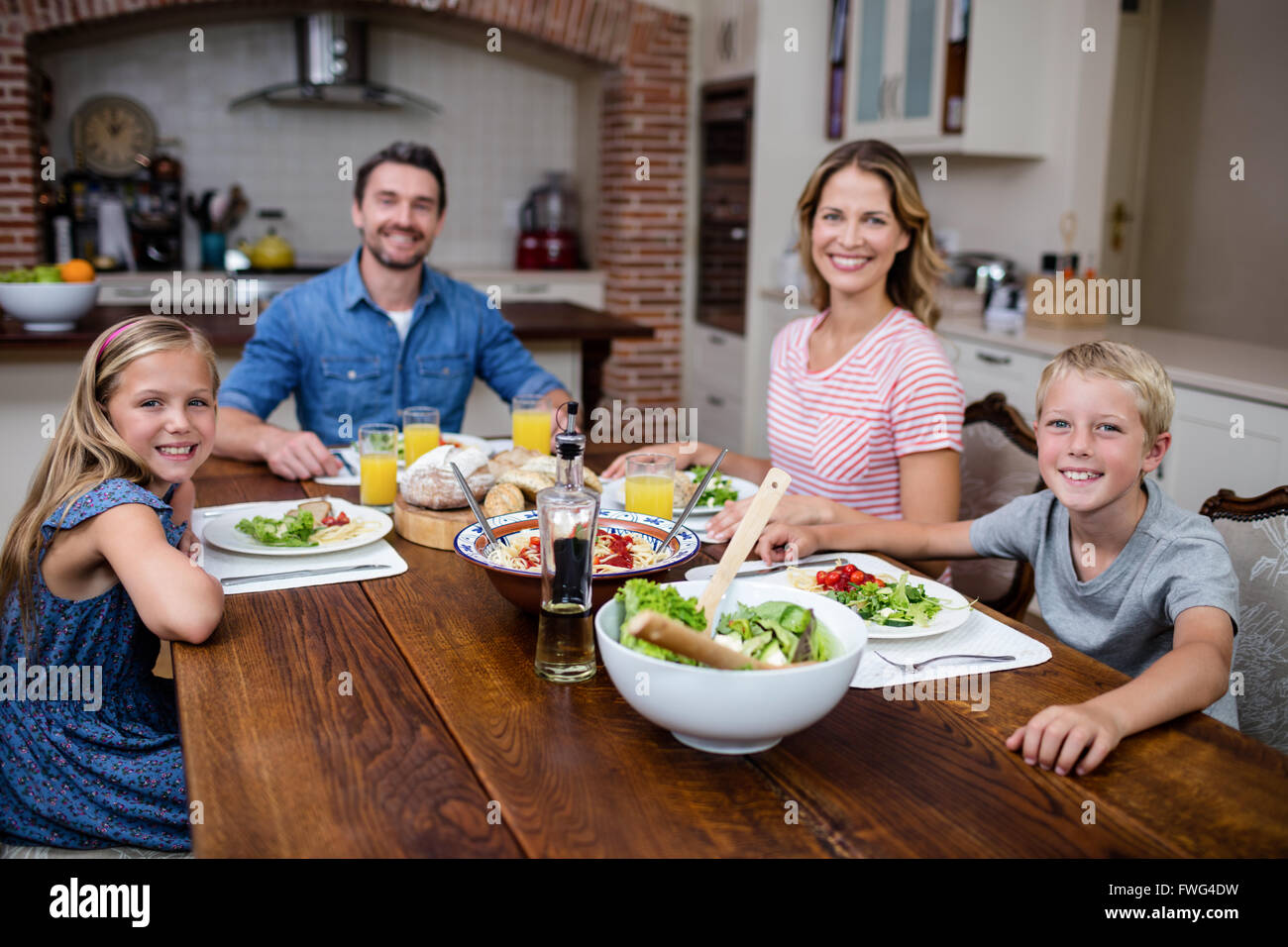home, house, household, homey, apartment, domicile, kitchen, dinning table, wooden spoon, bowl, food - Stock Image