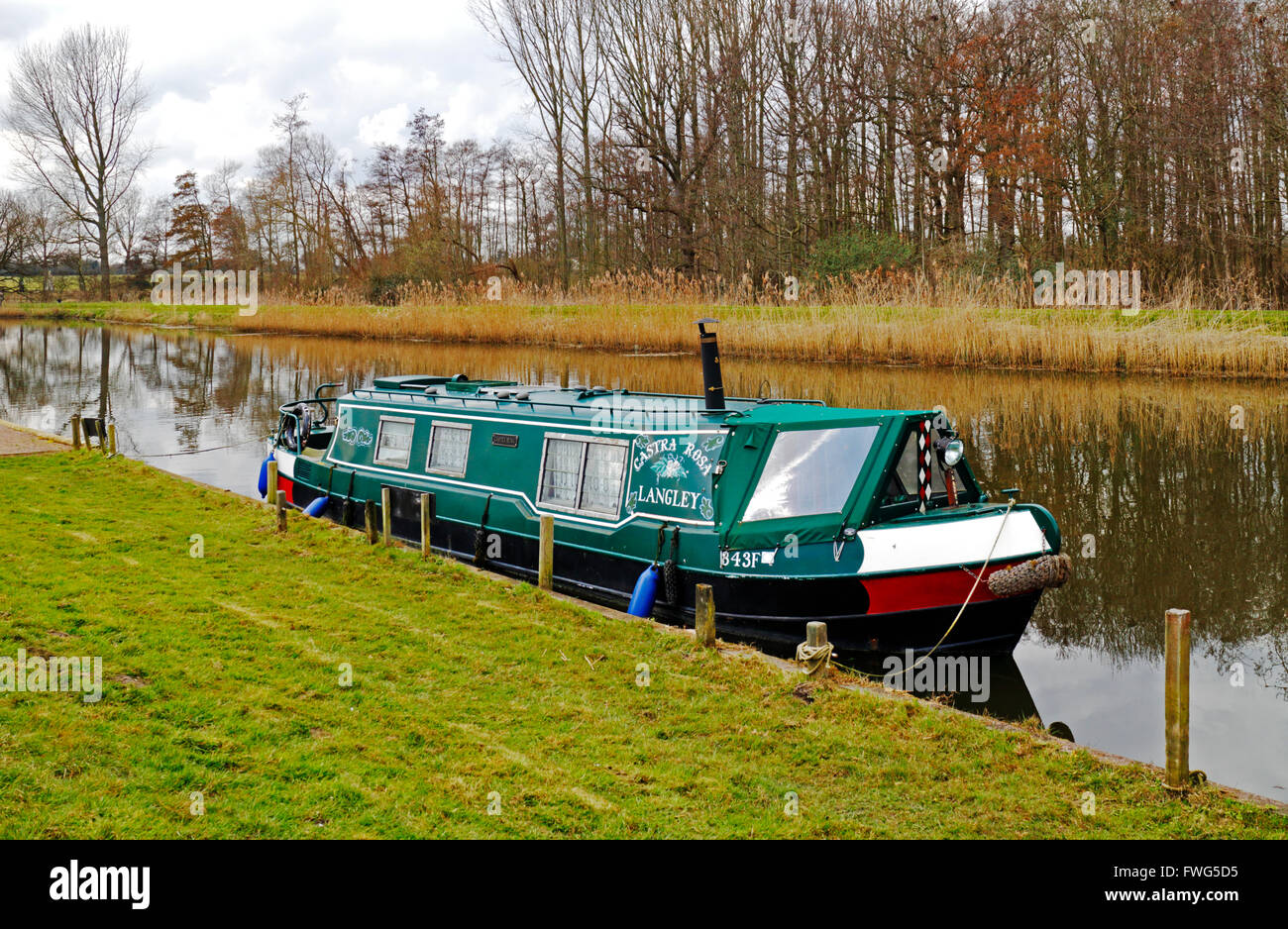 A longboat moored in Langley Dyke on the Norfolk Broads at Langley, Norfolk, England, United Kingdom. - Stock Image