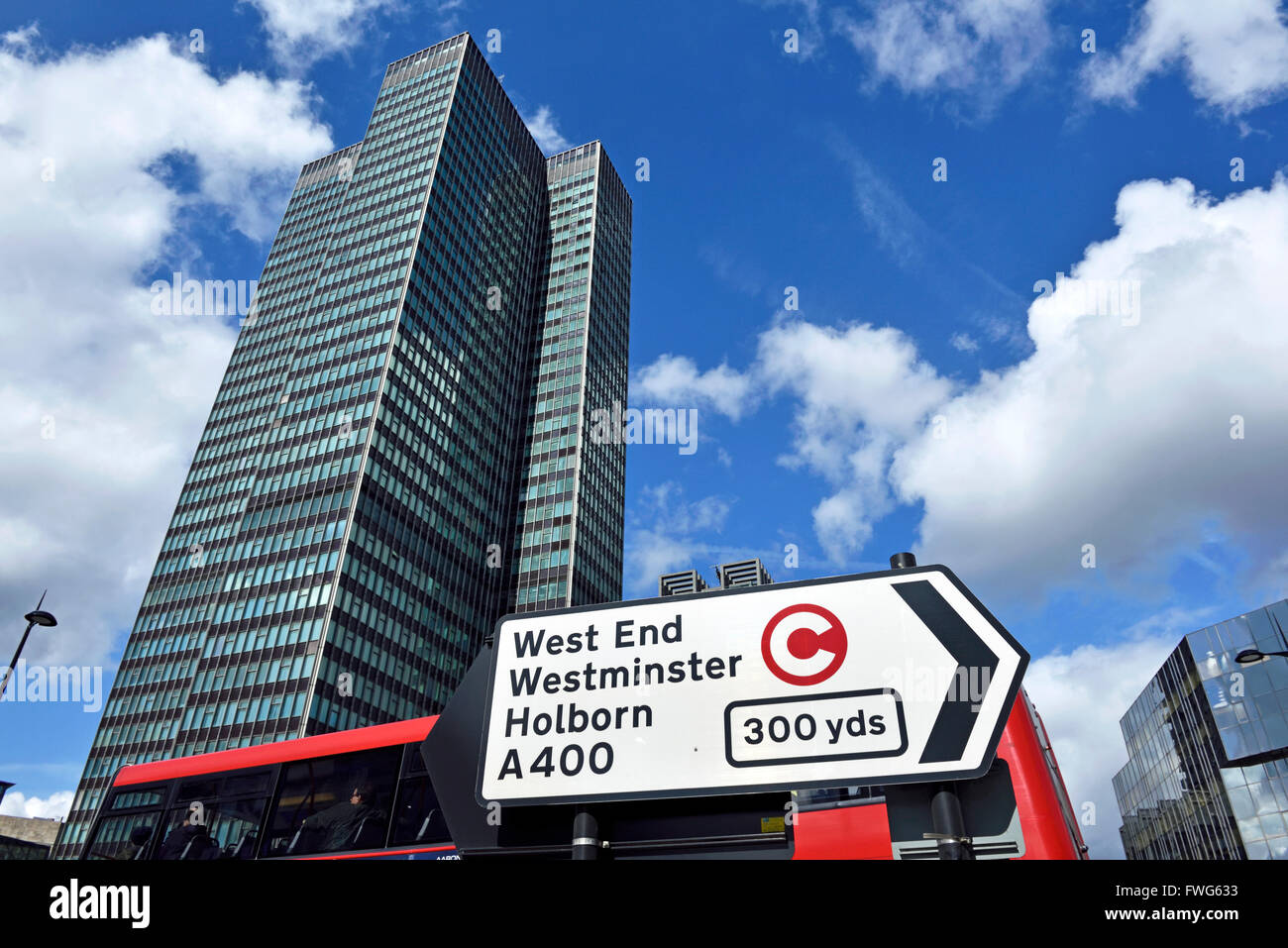 Traffic direction sign with congestion charge symbol, EustonTower in background, Euston Road Central London England - Stock Image