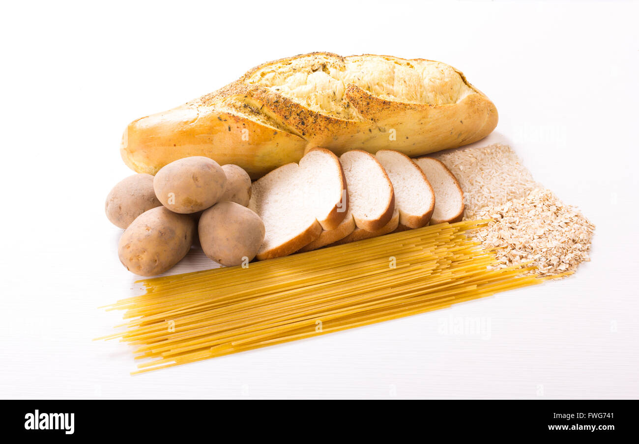 Group of carbohydrates for diet, bread, rice, oat, potatoes, pasta on wood tableGroup of carbohydrates for diet, - Stock Image