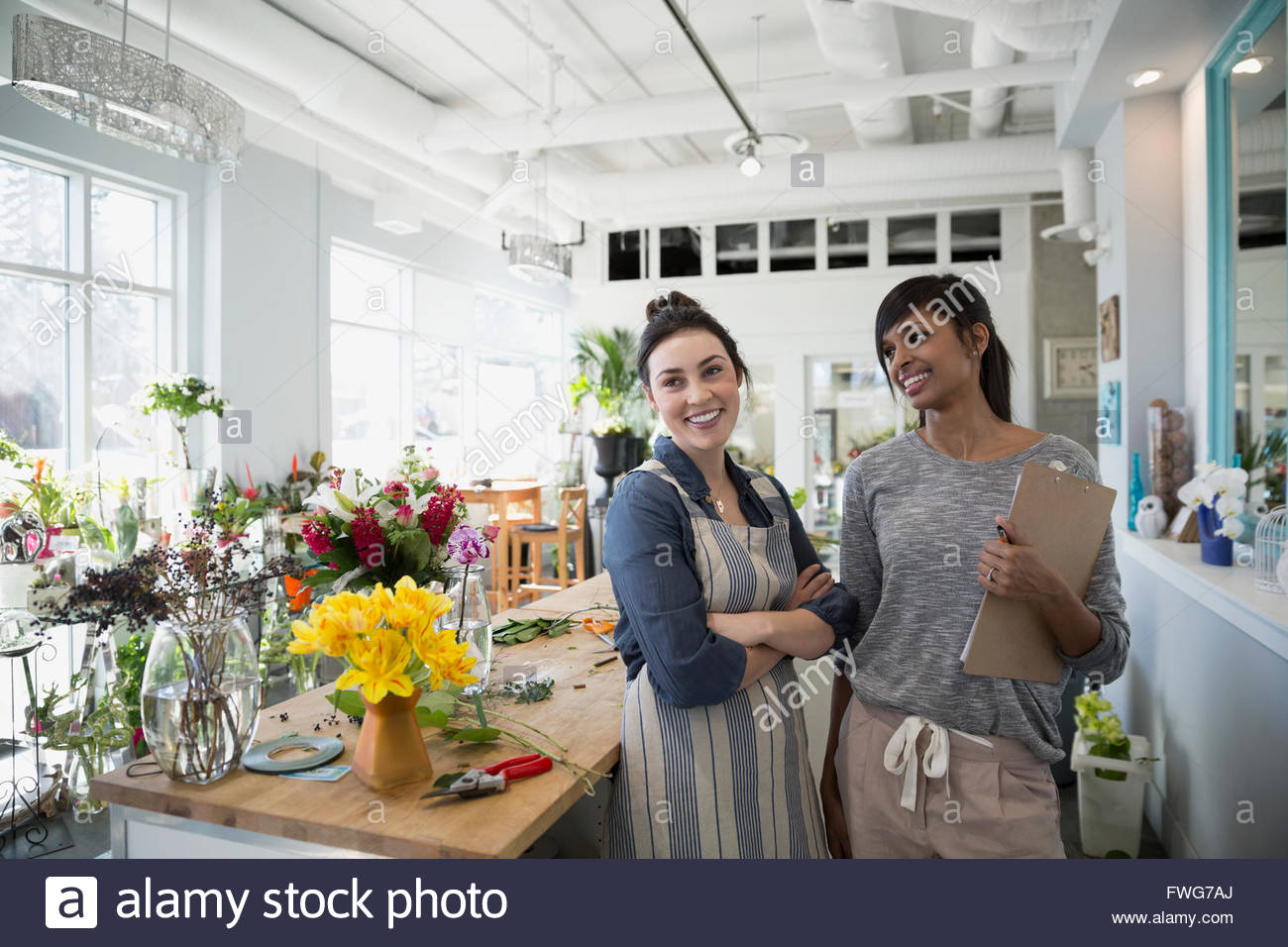 Smiling florists in flower shop - Stock Image