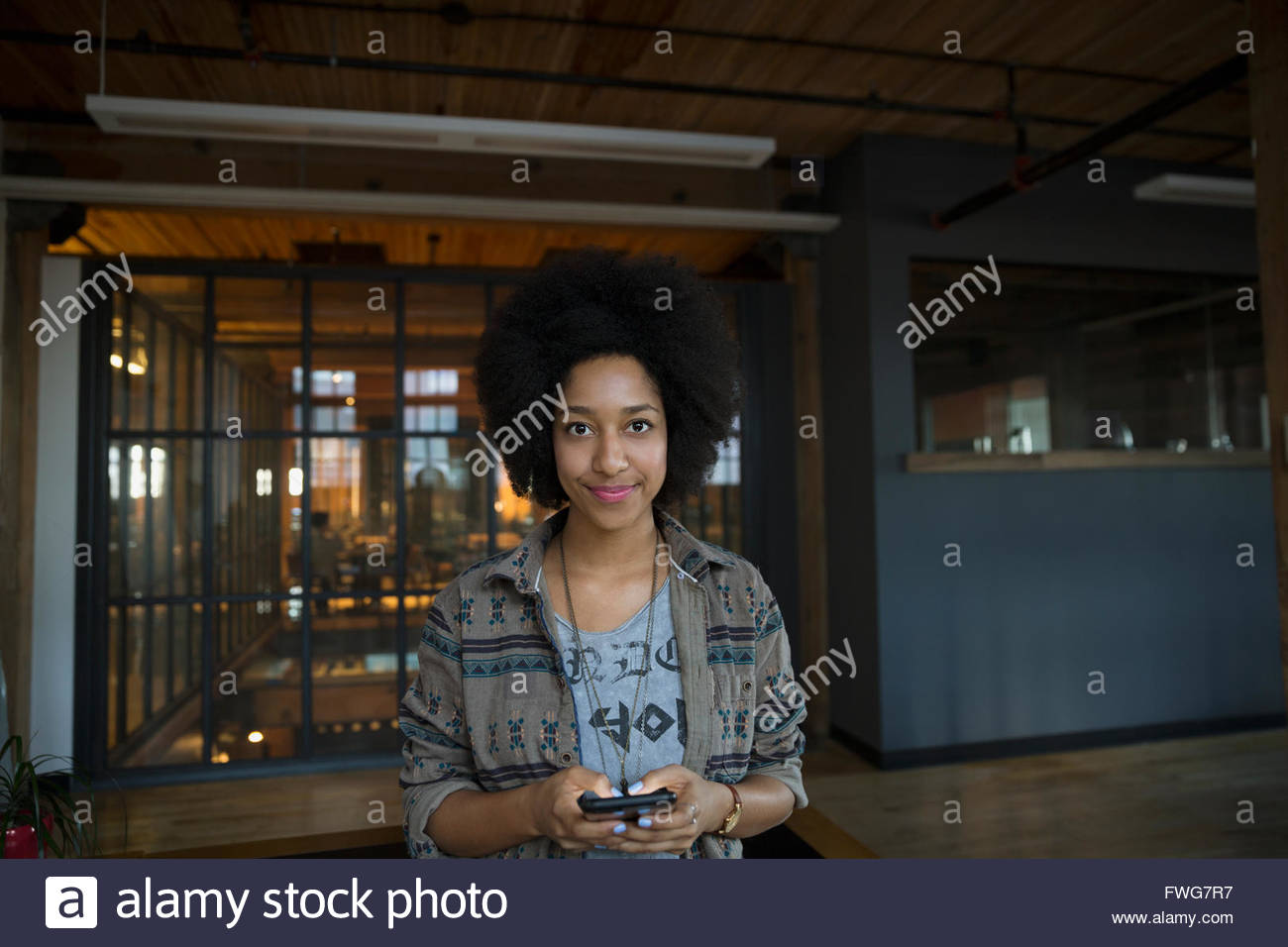 Portrait confident woman texting - Stock Image
