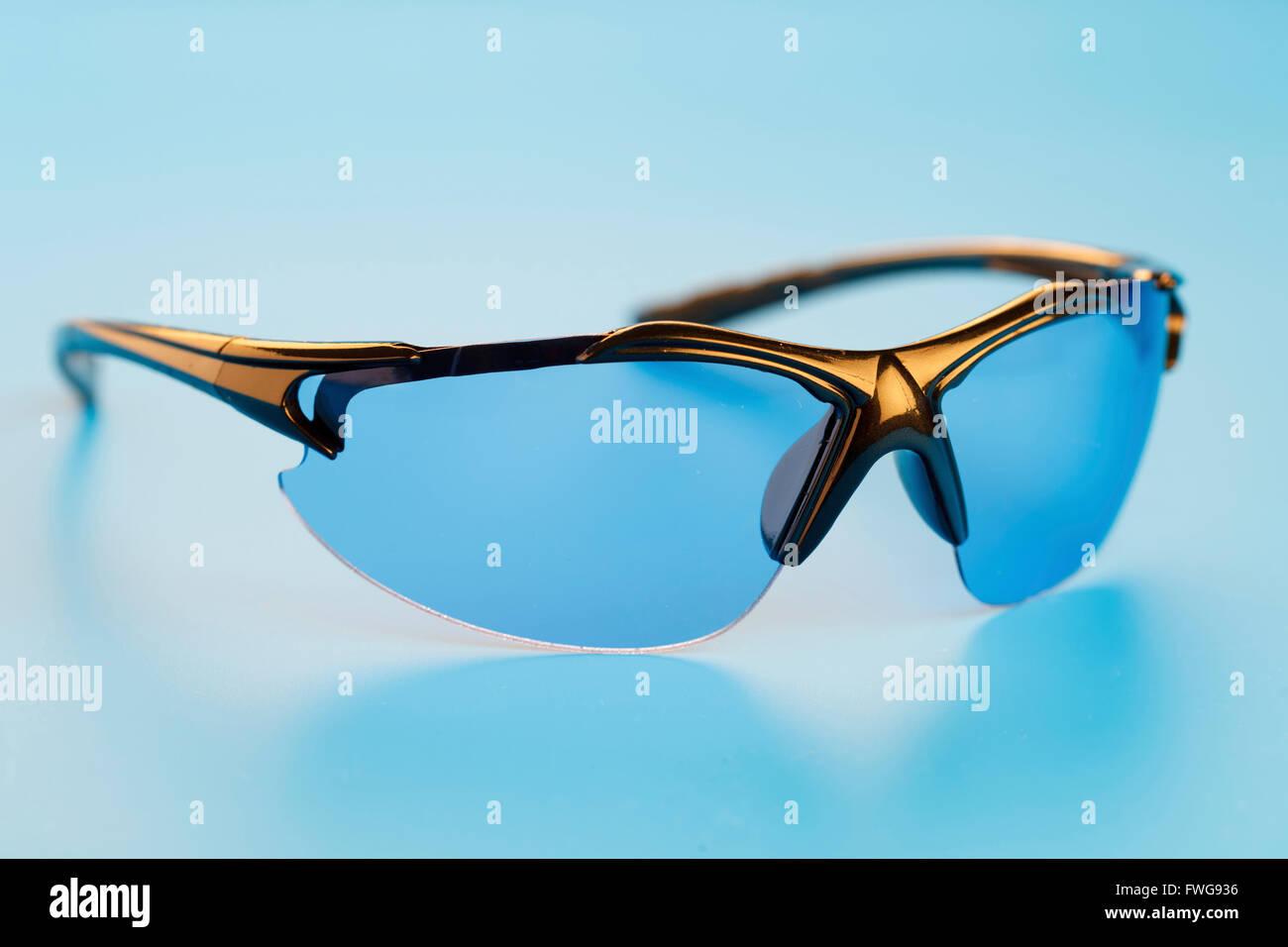 Eyeglasses against a blue background. - Stock Image