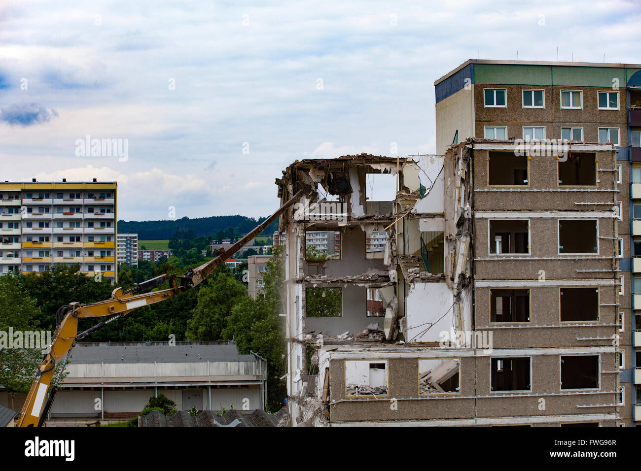 Apartments being demolished. - Stock Image