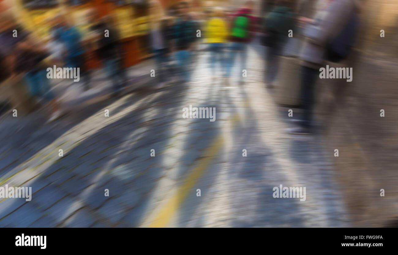 People in the street, blurred motion. - Stock Image