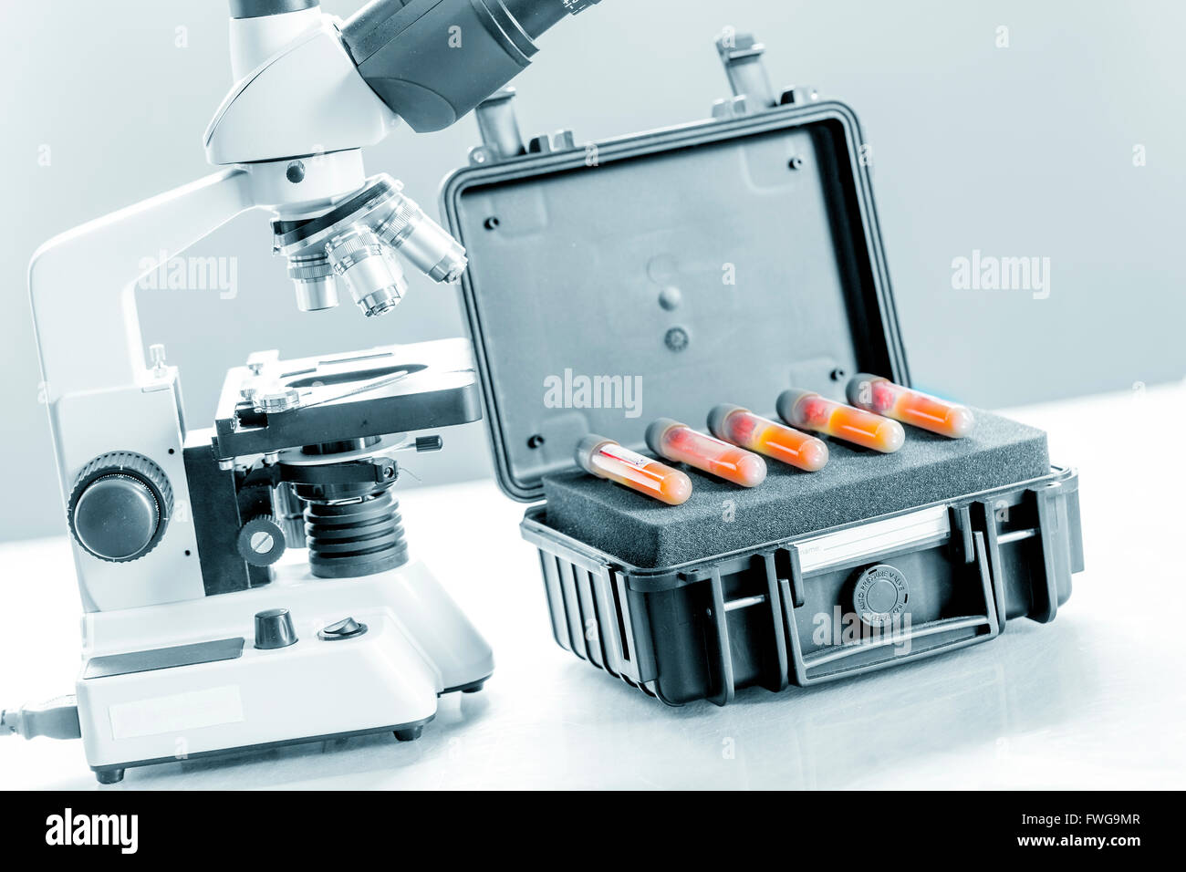 Infectious blood samples in a protective case. - Stock Image