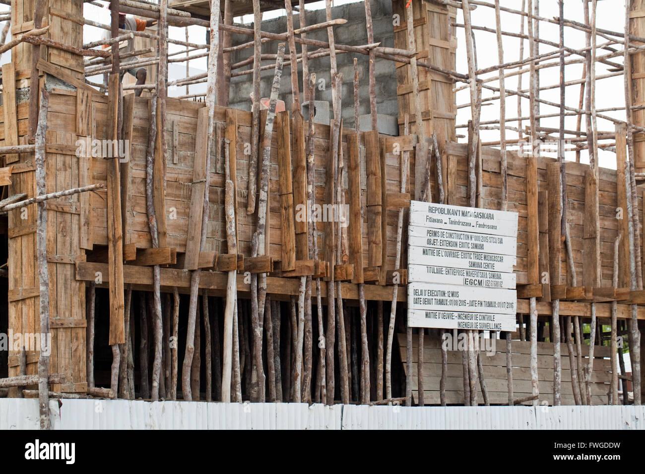 Building Construction. Wood Scaffolding. Sambava. Madagascar. - Stock Image
