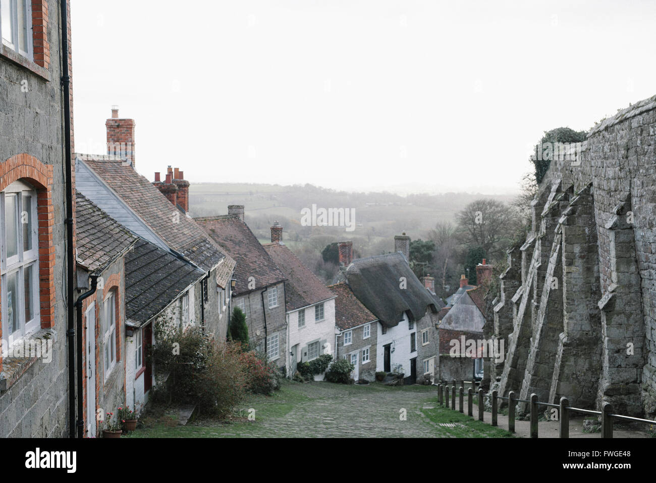 Gold Hill, a steep cobbled street in Shaftesbury, lined with cottages. - Stock Image