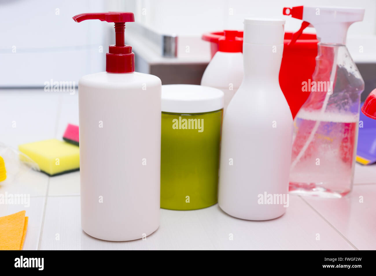 Assortment of household cleaning products in a variety of containers, spray bottles and pumps in a hygiene and housework - Stock Image