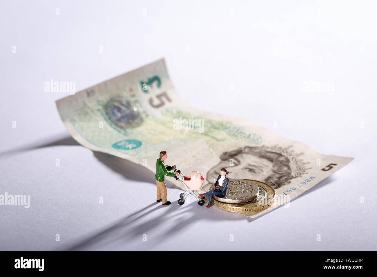 Photo of a family with seven pound twenty pence the new living wage for the UK - Stock Image
