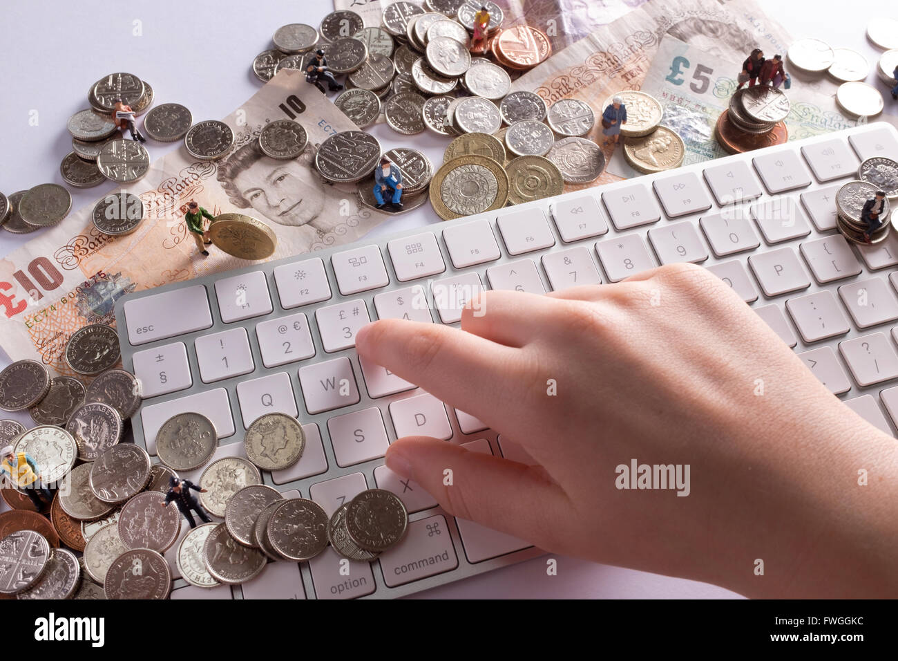 Crowd funding concept image showing how people can come together to raise funds  using the internet - Stock Image