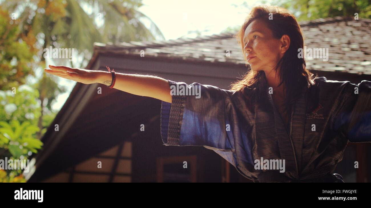 Low Angle View Of Woman Exercising At Home - Stock Image
