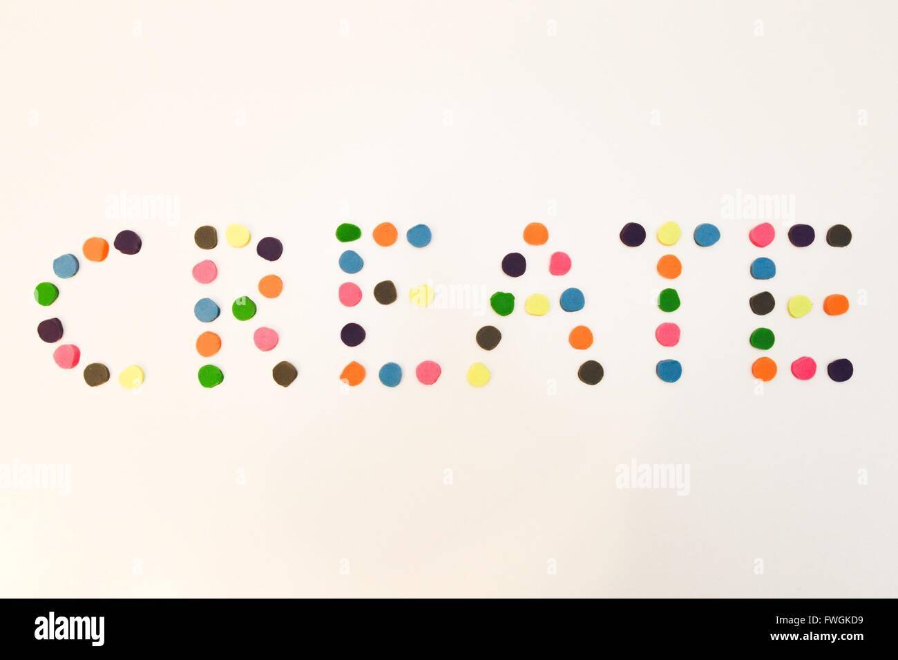 Create Text Made Of Multi Colored Dots On White Background - Stock Image