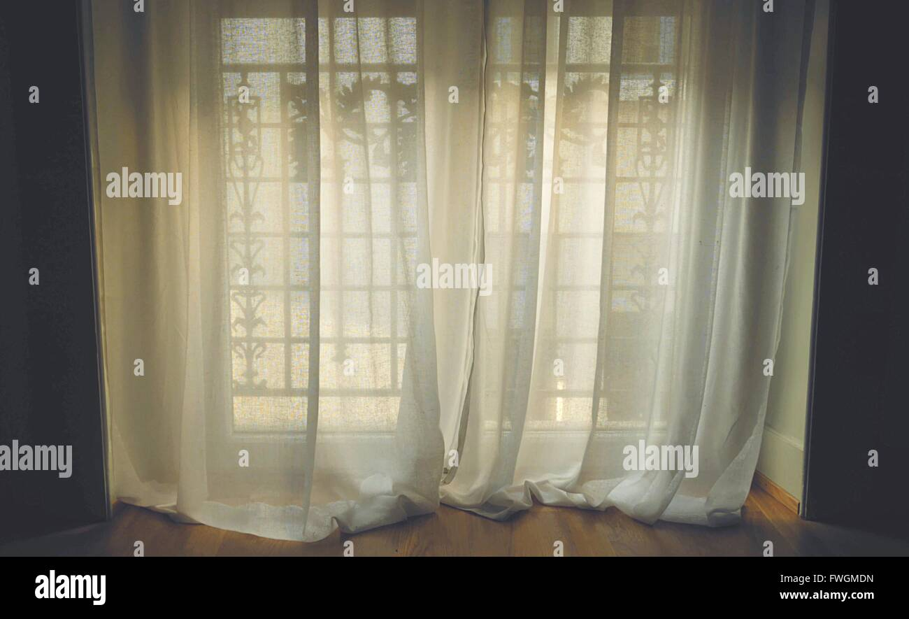 Window With White Curtain - Stock Image