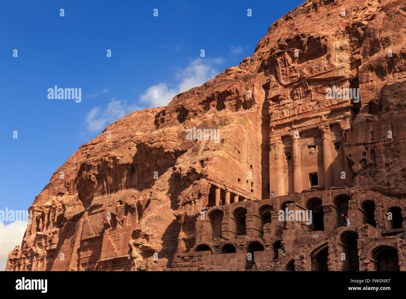 Tourist around the Urn Tomb, Royal Tombs, Petra, UNESCO World Heritage Site, Jordan, Middle East Stock Photo