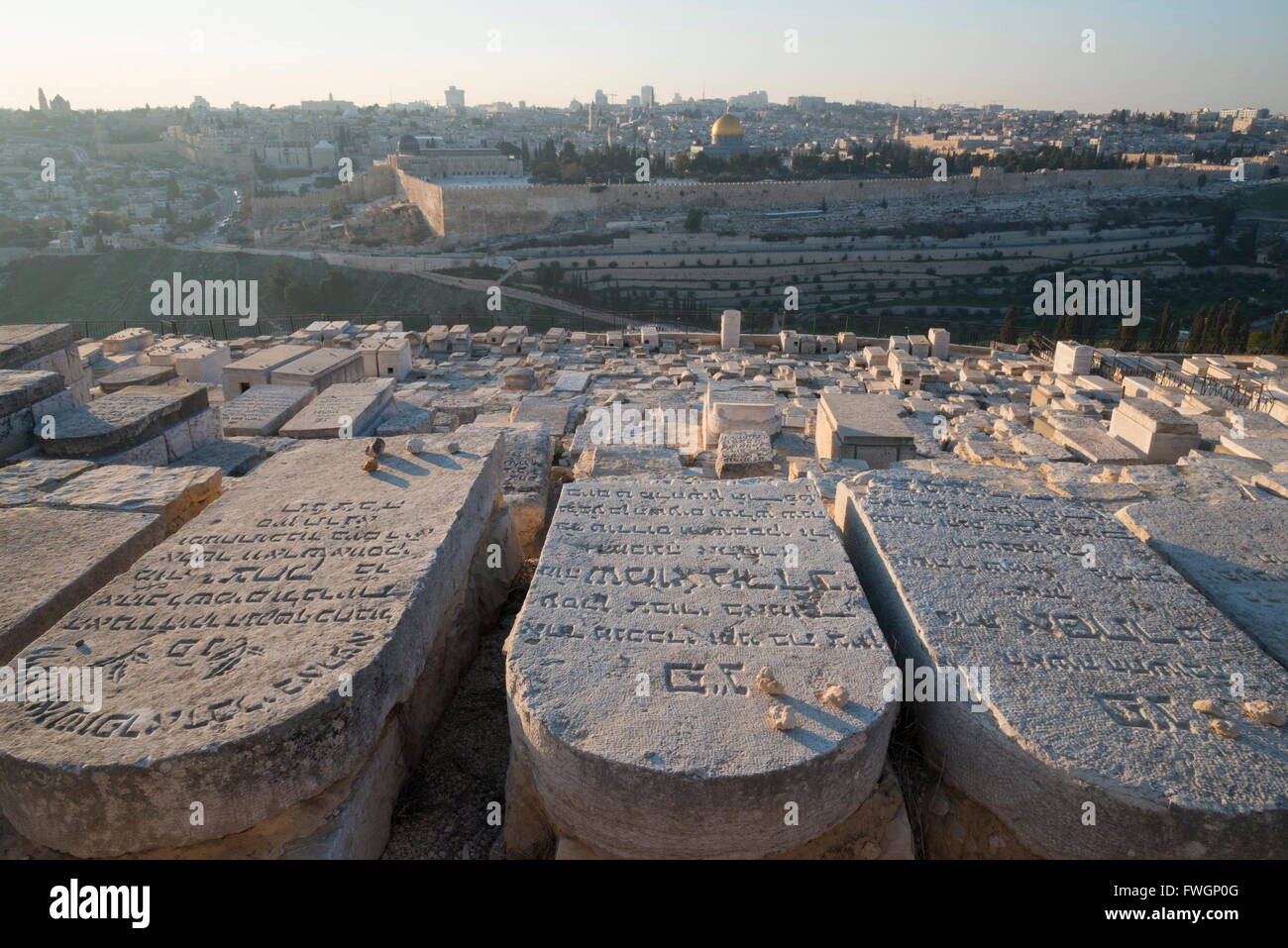 Tombstones on the Mount of Olives with the Old City in Background, Jerusalem, Israel, Middle East - Stock Image