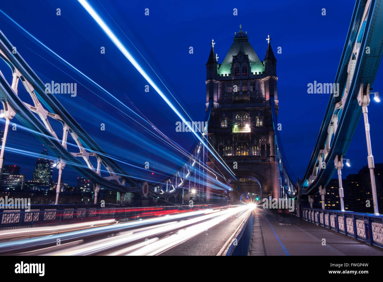 Light trails on London bridge in the evening, London, United Kingdom, Europe - Stock Image