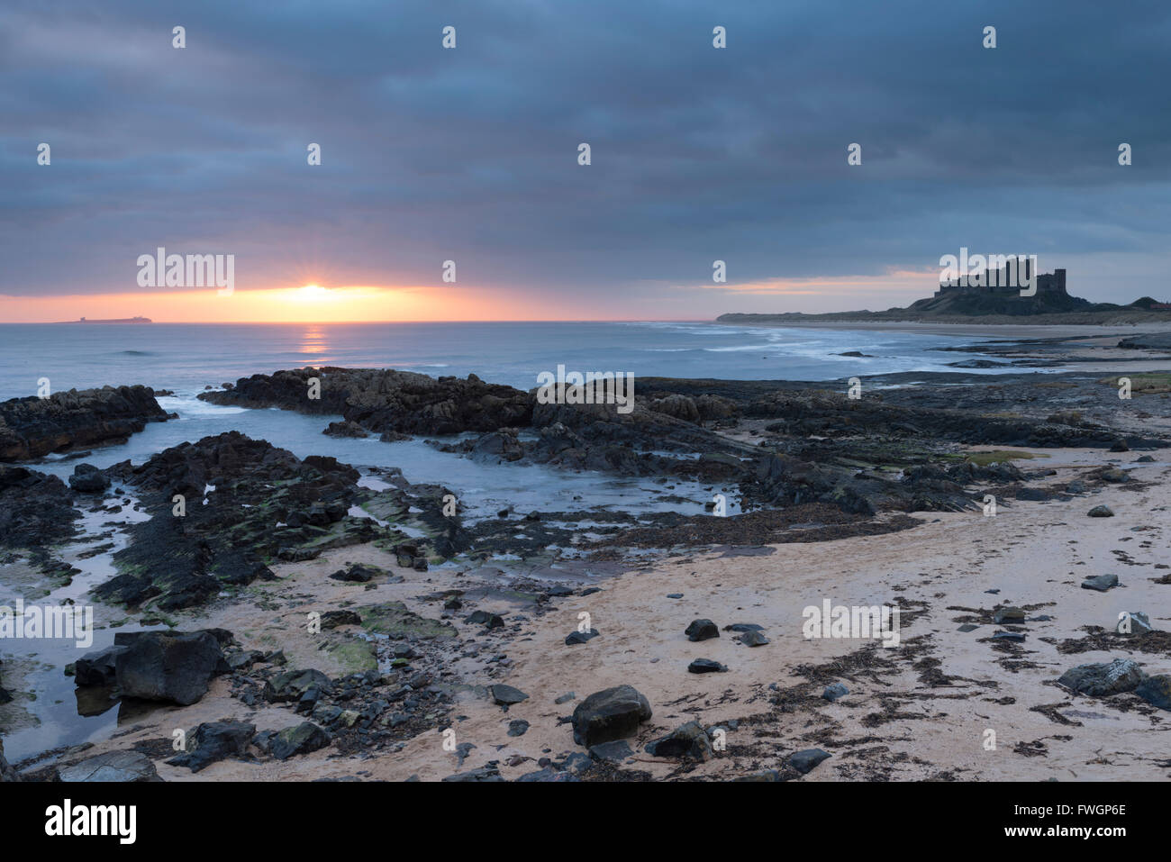 Sunrise at Bamburgh, Northumberland, England, United Kingdom, Europe - Stock Image