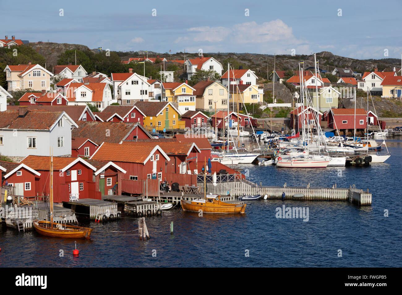 Falu red fishermen's houses in harbour, Halleviksstrand, Orust, Bohuslan Coast, Southwest Sweden, Sweden, Scandinavia, - Stock Image