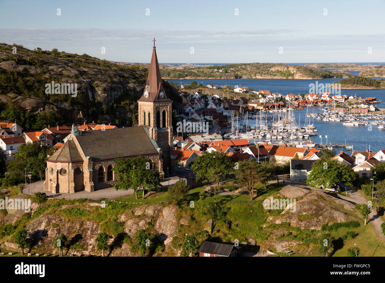 View over harbour and town with Vetteberget cliff, Fjallbacka, Bohuslan Coast, Southwest Sweden, Sweden, Scandinavia, - Stock Image