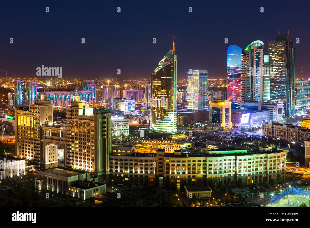 The city center and central business district at night, Astana, Kazakhstan, Central Asia - Stock Image