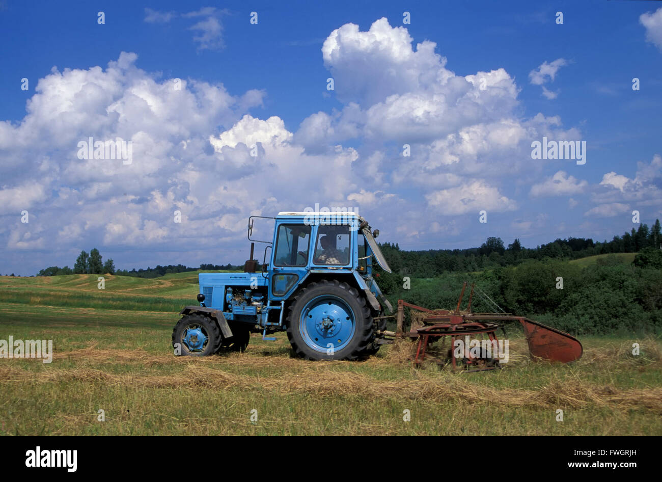 Tractor at work, Estonia, Europe - Stock Image