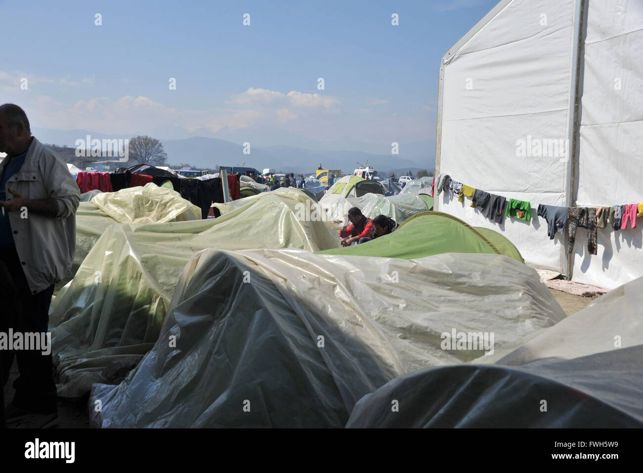 For weeks rain in Idomeni. Some tents are still protected by tarpaulins. - 29 March 2016 - Stock Image