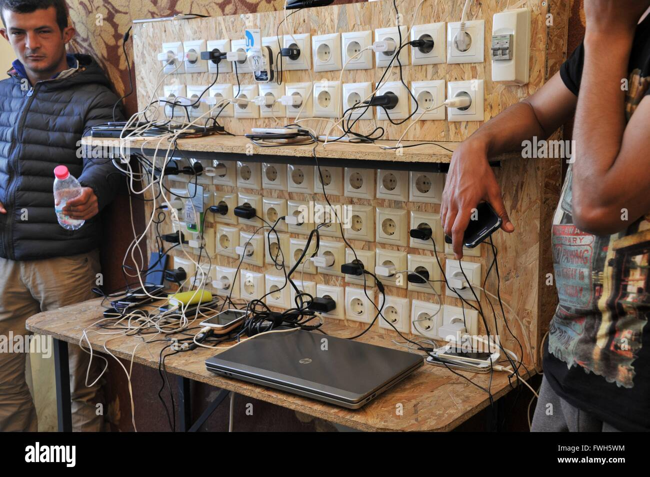 In every big tent you will find it - a charging station. One is always taking care that no laptop or phone gets - Stock Image
