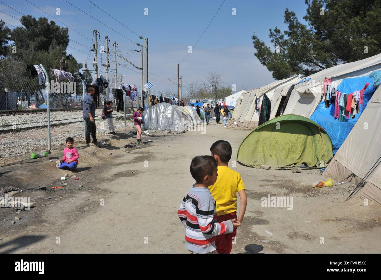 100 meters to the locked limit, tents along the railway line, children looking for employment - 29 March 2016 - Stock Image