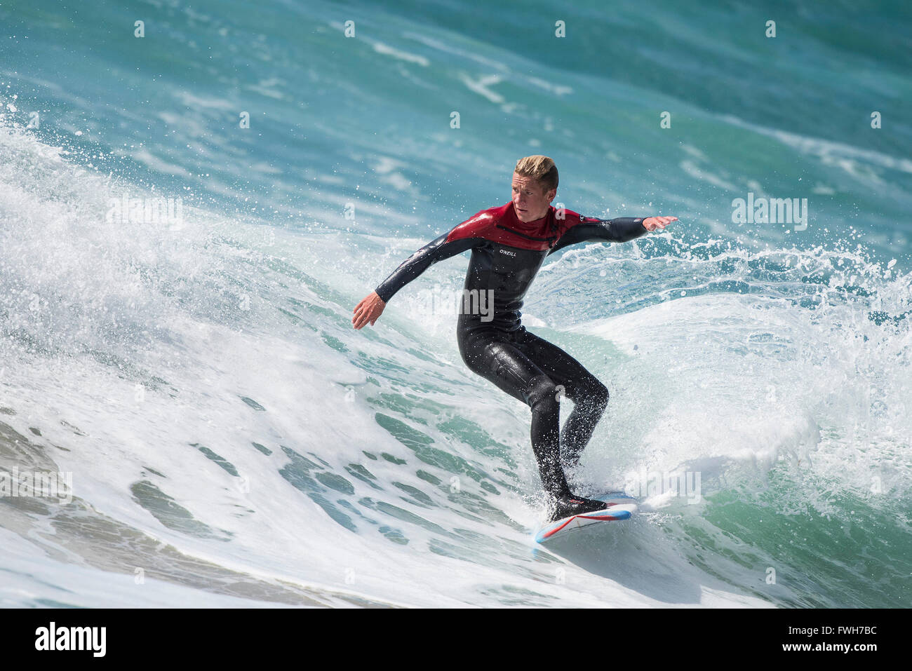 Fistral Beach, Newquay, Cornwall, 5th April 2016. UK Weather: Noah Anstis, a local surfer aged 16, enjoys the windy - Stock Image