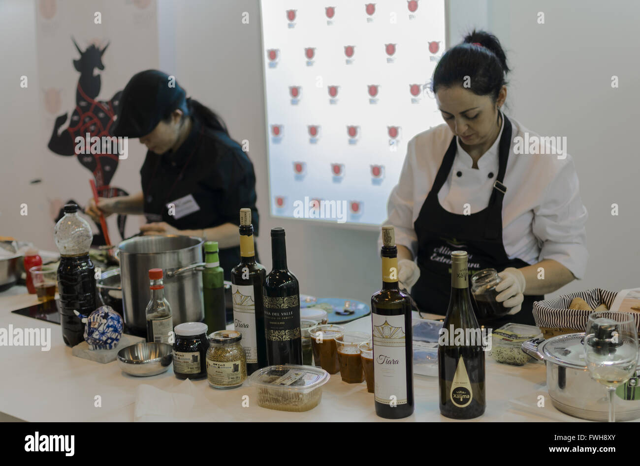 Madrid, Spain, 5 th April 2016. Ifema. Two women in a stand of the Gourmet food fair. Enrique Davó/Alamy Live - Stock Image