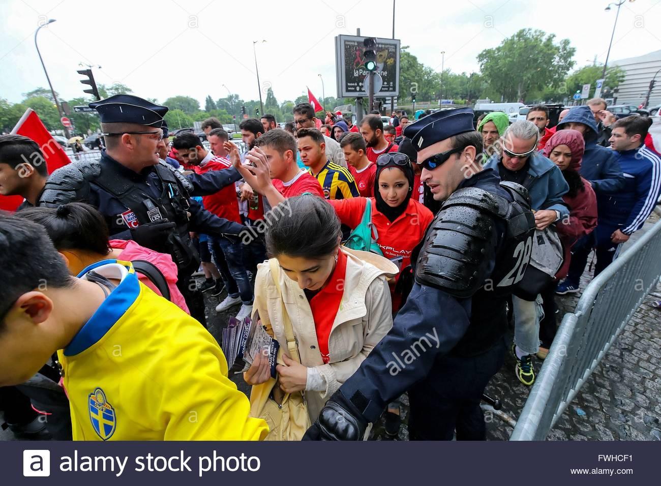 Paris,France. June 12nd, 2016. FRANCE, Paris: Police officers manage supporters at the entrance of Parc des Princes - Stock Image