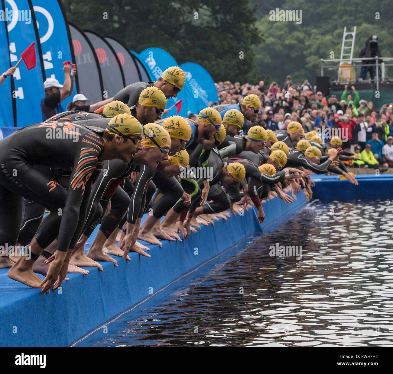 Leeds, UK. 12th June, 2016. Elite men starting the open water swim in the first leg of the WTS Triathlon at Leeds, - Stock Image