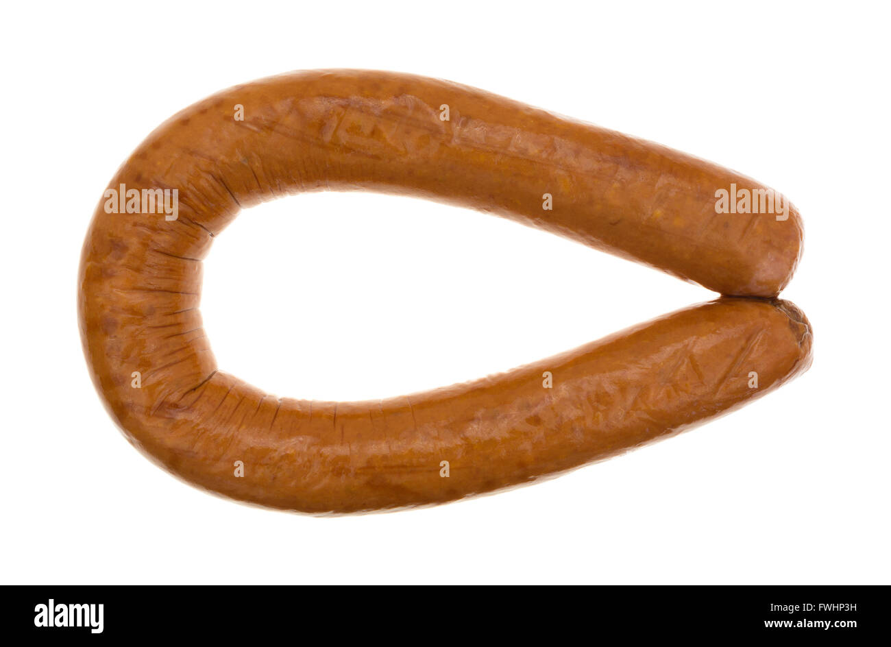 top view of a bent full length reduced calorie kielbasa sausage