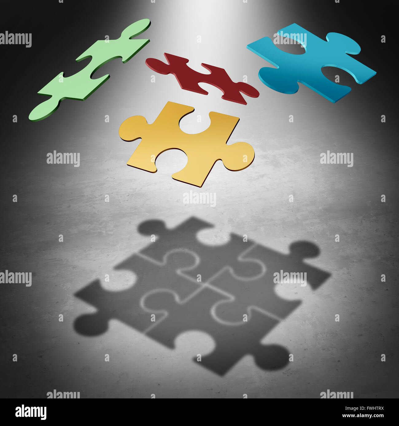Putting the puzzle together teamwork concept as a business success symbol with four divided pieces of a jigsaw puzzle - Stock Image